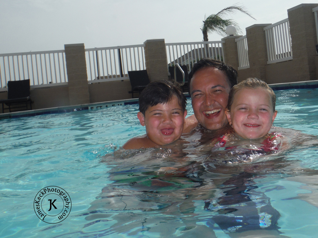 Father, Son, and Daughter in Swimming Pool