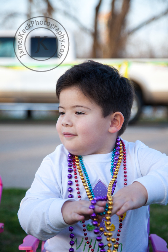 William with Beads Sitting Down