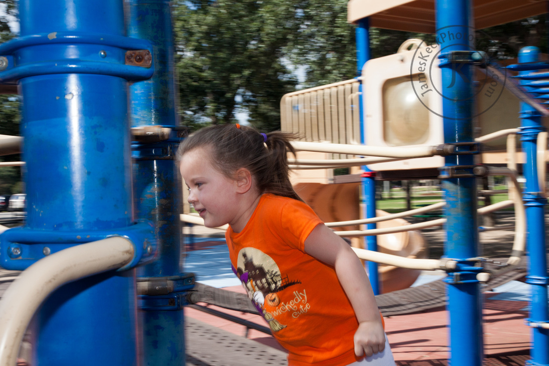 Portrait of Girl Playing at the Playground at Mary Jo Peckham Park
