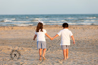 Brother and Sister Holding Hands on the Beach Portrait