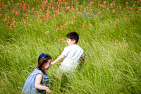 Portrait of Children Running through Wildflowers