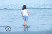 Portrait of Little Girl Wading in the Water at the Beach