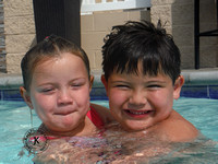 Portrait of Brother and Sister in Swimming Pool