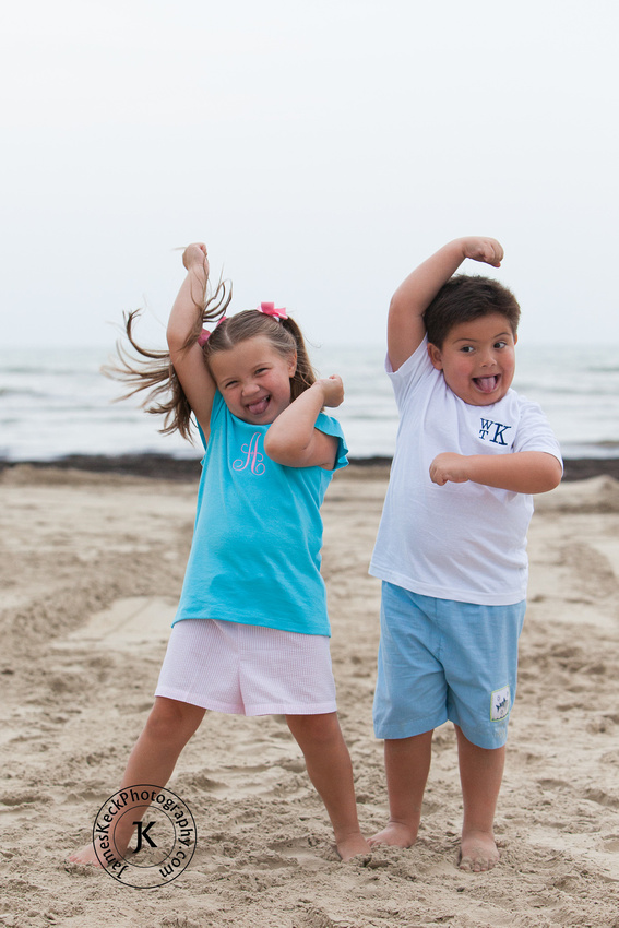 Brother and Sister Acting Silly on Beach