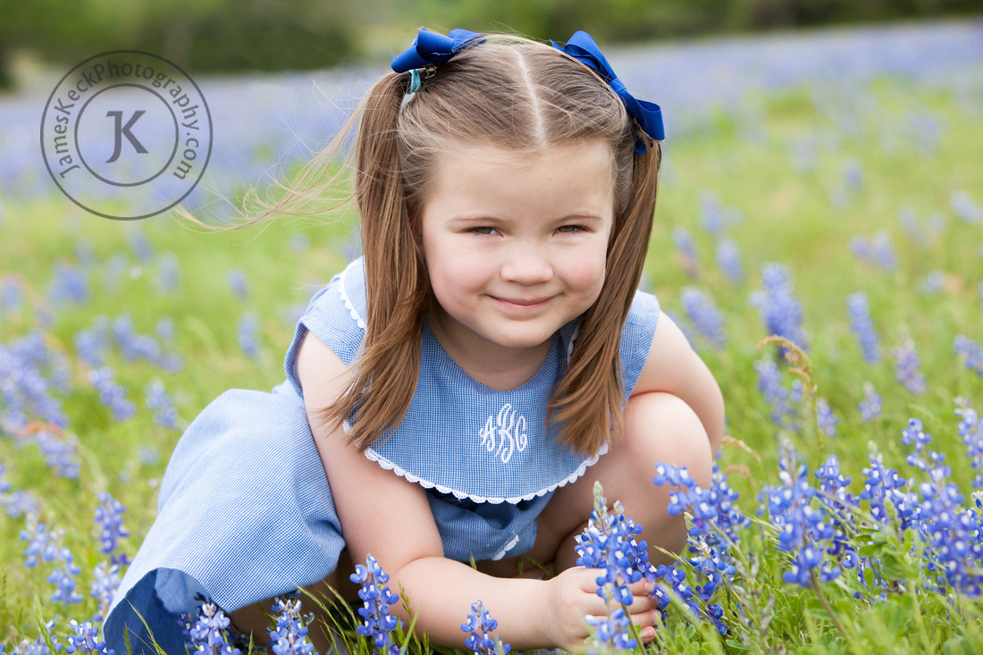Portrait of Girl Picking Bluebonnets