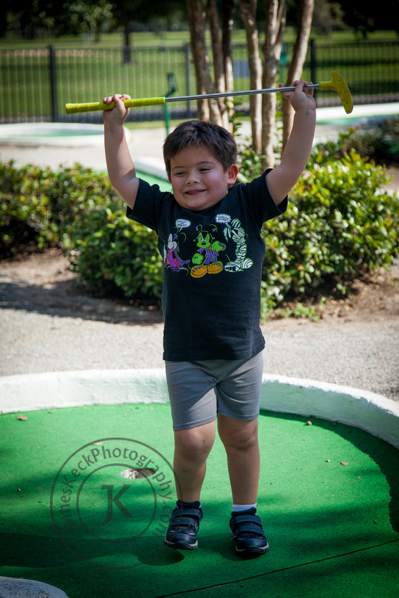 Portrait of Boy Golfing at Mary Jo Peckham Park