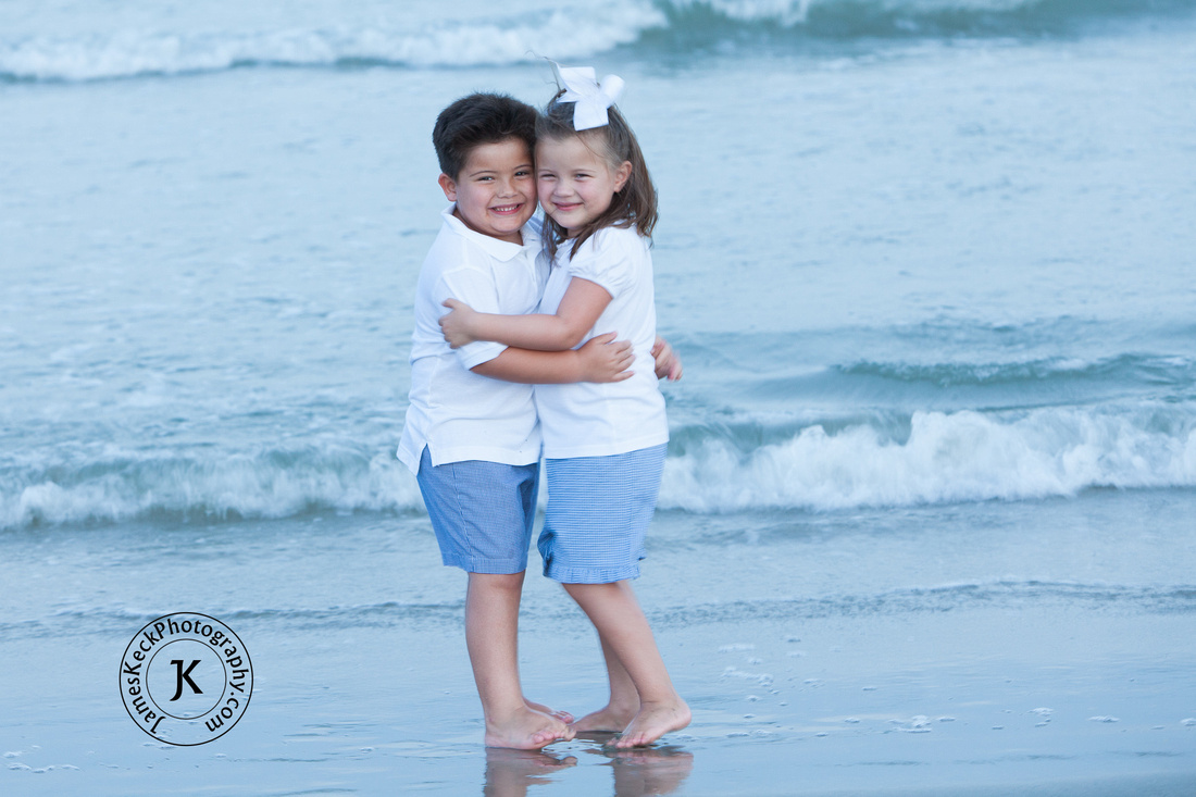 Portrait of Brother and Sister Hugging on the Beach