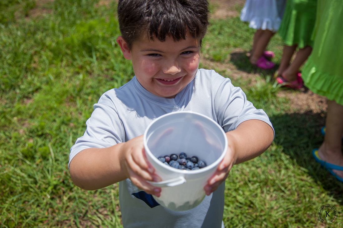 Photo of William with Blueberries