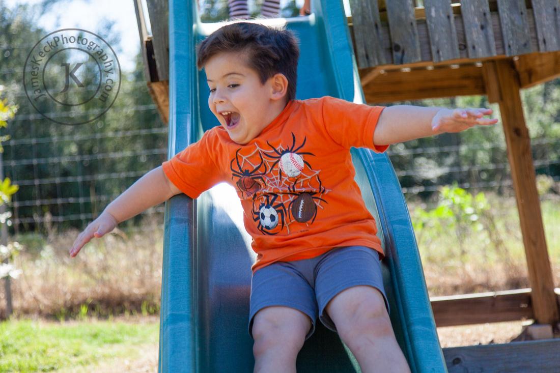 Portrait of Boy Sliding at Matt Family Orchard
